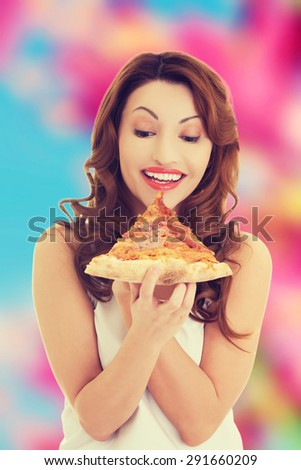 Happy beautiful woman eating pizza - stock photo