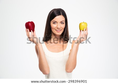 Happy beautiful woman holding two apples isolated on a white background - stock photo