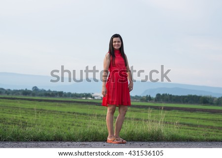 Happy beautiful woman in red dress joyful and cheerful smiling. - stock photo