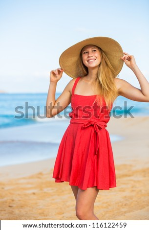 Happy Beautiful Woman in Red Dress on the Beach - stock photo