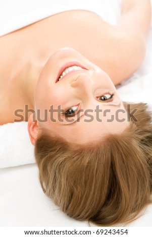 Happy beautiful woman in spa center