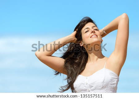 Happy beautiful woman on summer day. Relax and enjoy in sunny day. Caucasian girl happiness and copy space. - stock photo