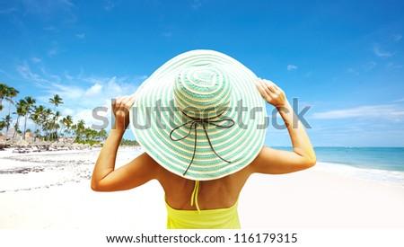 Happy beautiful woman on the beach. Vacation. - stock photo