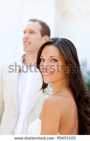 Happy beautiful woman portrait with man in blur background