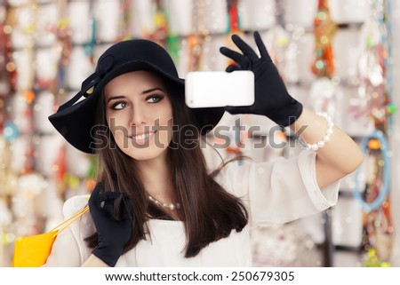Happy Beautiful Woman Shopping Taking a Selfie - Portrait of a young elegant girl with shopping bags  - stock photo