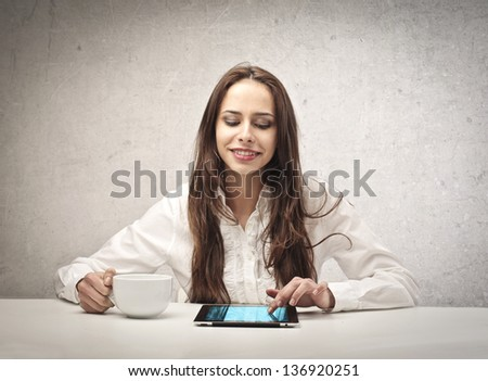 happy beautiful woman with a cup and tablet - stock photo