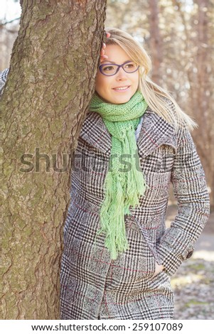Happy Beautiful Young Caucasian Woman Portrait outdoor. Winter Autumn season daylight cheerful lifestyle. - stock photo