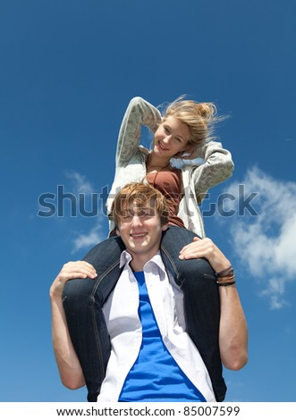 happy beautiful young couple having fun in sunny day - stock photo