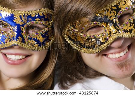 Happy beautiful young couple wearing masks - stock photo