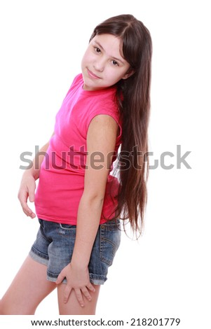 Happy beautiful young girl poses for a picture