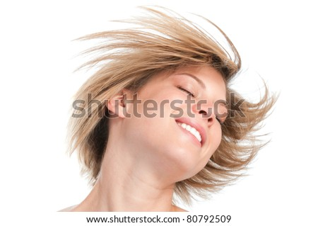 Happy beautiful young girl shaking head with her new straight hairstyle isolated on white background - stock photo