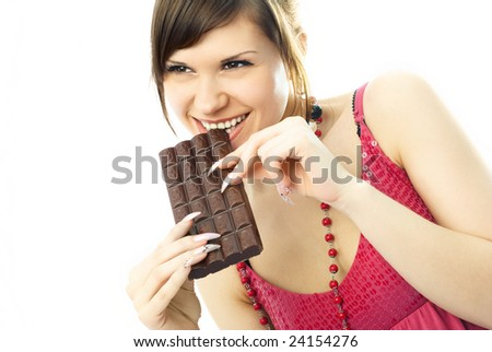 happy beautiful young woman eating a bar of chocolate - stock photo