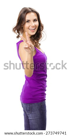 Happy beautiful young woman in casual smart lilac clothing, showing two fingers or victory gesture, isolated against white background - stock photo