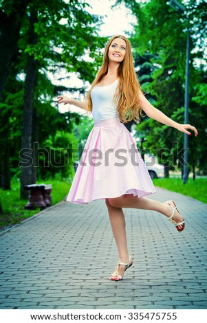 Happy beautiful young woman in light summer clothes enjoying sunny summer day. Beauty, fashion. - stock photo