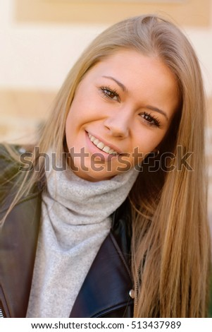 Happy beautiful young woman laughing and smiling on street