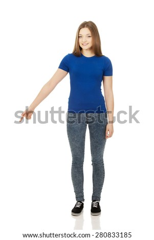 Happy beautiful young woman pointing down. - stock photo