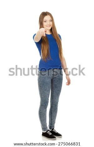 Happy beautiful young woman pointing on you. - stock photo