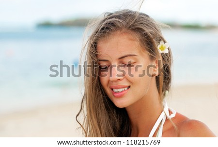happy beautiful young woman smiling on tropical beach - stock photo