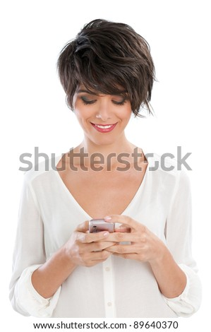 Happy beautiful young woman text messaging and surfing the net with her smart phone isolated on white background - stock photo