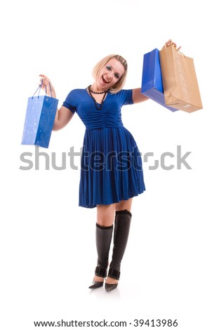 happy beautiful young woman with shopping bags - stock photo