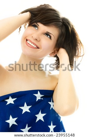 happy beautiful young woman wrapped into an American flag - stock photo