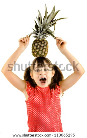 happy beauty little girl, hold pineapple and smile, on white background, isolated - stock photo