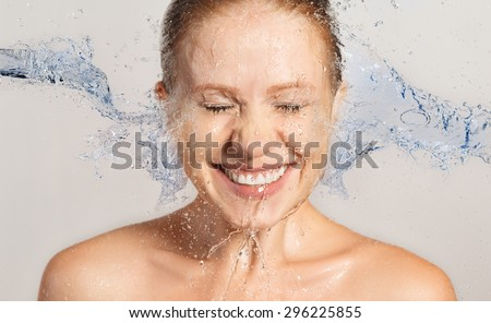 Happy beauty woman skin care, washing with splashes and drops of water - stock photo