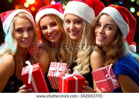Happy beautyful girls with Christmas gifts - stock photo