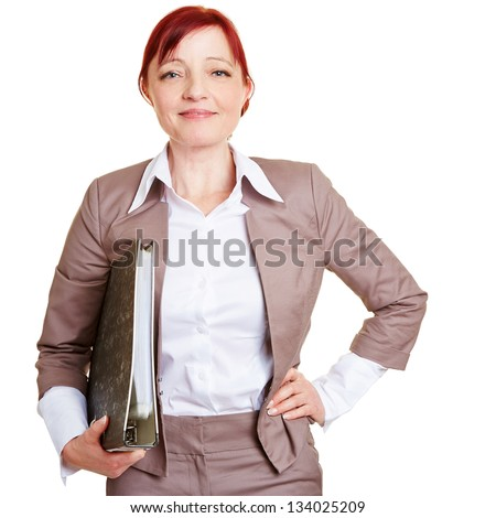 Happy best ager business woman with folder - stock photo
