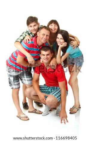 Happy big caucasian family having fun and smiling over white background. Mother, father and children - daughter with her husband and son teenager - stock photo