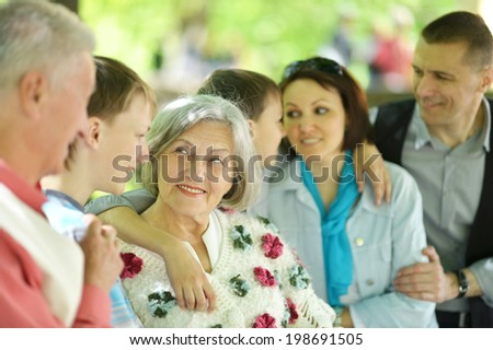 happy big family in a summer park - stock photo