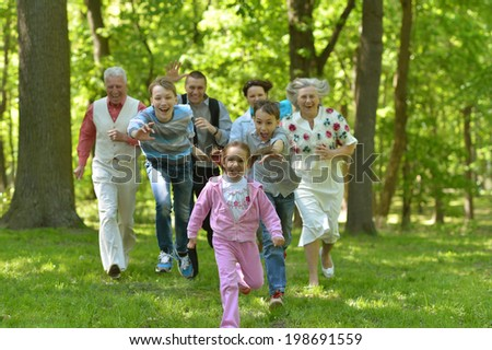 Happy big family walking in summer park - stock photo