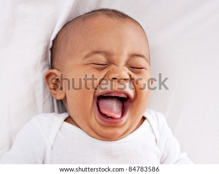 happy big laughing 7-month old African American baby boy - stock photo