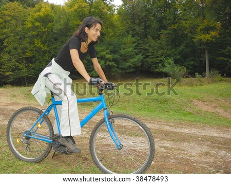 happy biker riding in autumn colorful environment