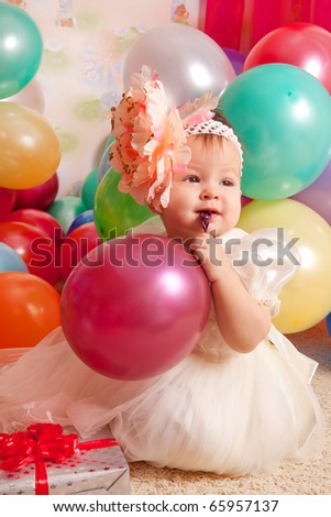 Happy birthday baby, Little girl with group ball. Play room. - stock photo