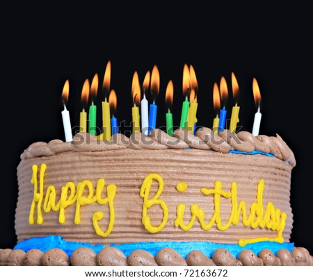 Happy birthday cake with lots of candles. - stock photo