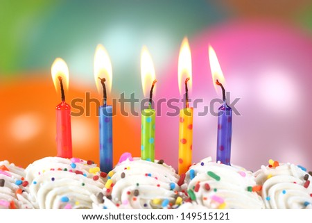 Happy Birthday Celebration with Balloons Candles and Cake - stock photo
