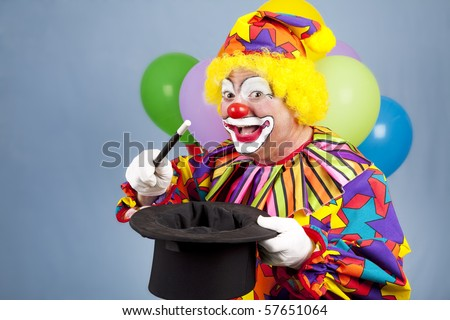 Happy birthday clown doing magic tricks with a top hat and wand.