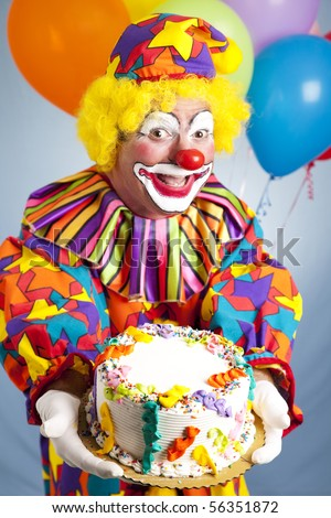 Happy birthday clown holding a birthday cake.  Cake is ready for your text. - stock photo