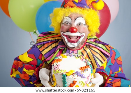 Happy birthday clown holding a blank cake ready for your text. - stock photo