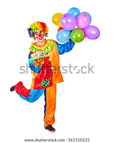 Happy birthday clown holding a bunch of balloons.   - stock photo