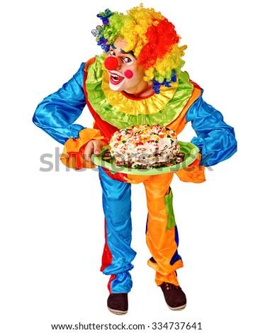 Happy birthday clown holding a cake .  Isolated. - stock photo