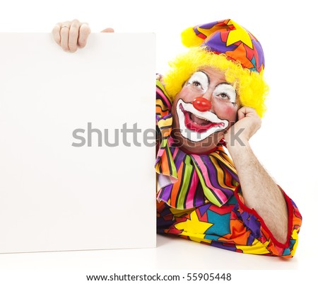 Happy birthday clown holding a sign and daydreaming.  Isolated on white.