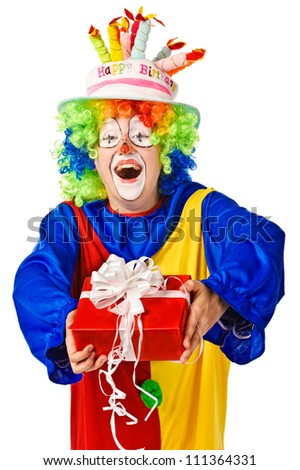 Happy birthday clown with gift box. Isolated over white