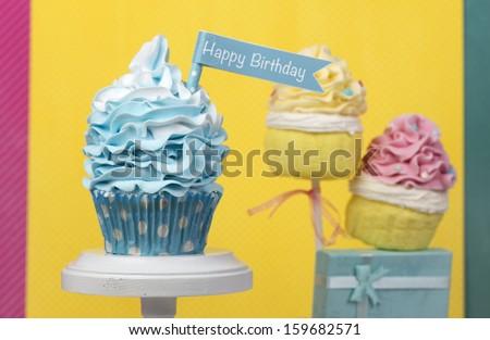 Happy Birthday cupcake and cupcake cake pops - stock photo