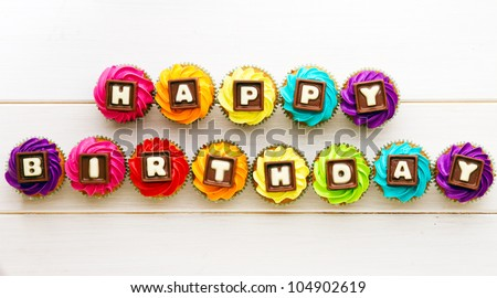 Happy birthday cupcakes - stock photo