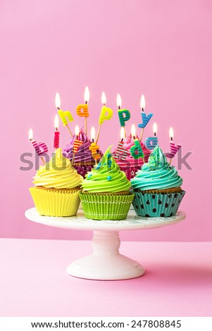 Happy birthday cupcakes on a cakestand - stock photo