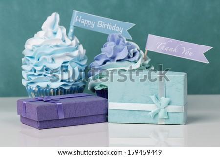 Happy birthday cupcakes with presents - stock photo