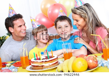 Happy Birthday. Father, mother and children celebrating birthday at home. - stock photo
