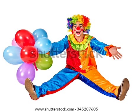 Happy birthday funny clown holding a bunch of balloons and sitting on floor.  Isolated. - stock photo